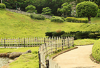 Stock image of garden lawn surrounded by wooden spiral fence.