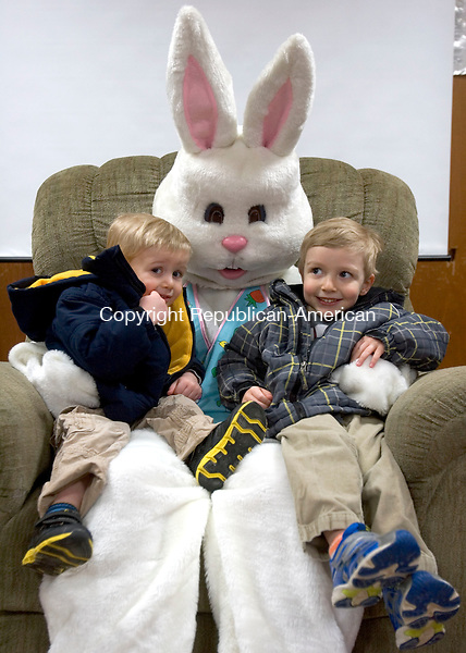 WINSTED CT. 30 March 2014-033014SV02-From left, Liam Waring, 2, sits on the Easter bunny&rsquo;s lap with his brother Nolan Waring, 4, of Winsted during the Fire Police fundraiser at the Prospect Street station of the Fire Department in Winsted Sunday. <br /> Steven Valenti Republican-American
