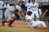Bluefield Orioles Michael Ohlman pushes Chris Wallace Greenville Astros off the plate at Pioneer Park in Greenville, Tennessee July 19, 2010.   Greenville won the game 7-6.  Photo By Tony Farlow/Four Seam Images