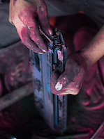 A migrant worker's hands are covered in ink  from discarded printers in a workshop in Guiyu. Each year, between 20 and 50 million tons of electronic waste is generated globally. Most of it winds up in the developing world. Some of the most popular destinations for dumping computer hardware include China, India, and Nigeria. It can be 10 times cheaper for a ìrecyclerî to ship waste to China than to dispose of it properly at home. With the market for e-waste expected to top $11 billion by 2009, itís lucrative to dump on the developing world.