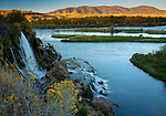 Idaho, East, Swan Valley. Fall River Falls cascades into the South Fork of the Snake River at sunset in autumn.
