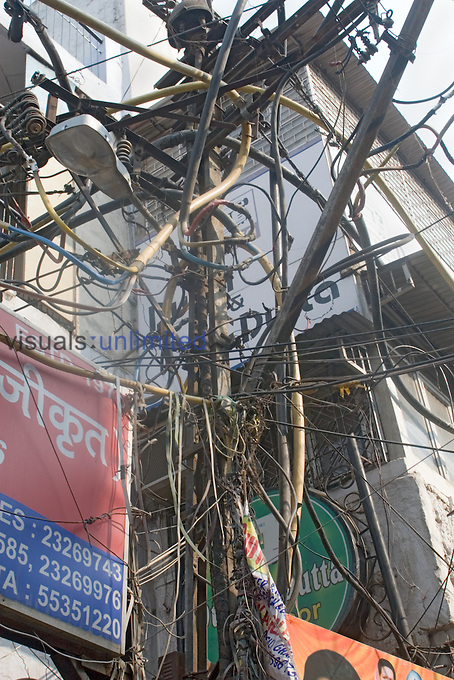 Maze of illegal wires tap into electrical line, Chandni Chowk, Delhi, India