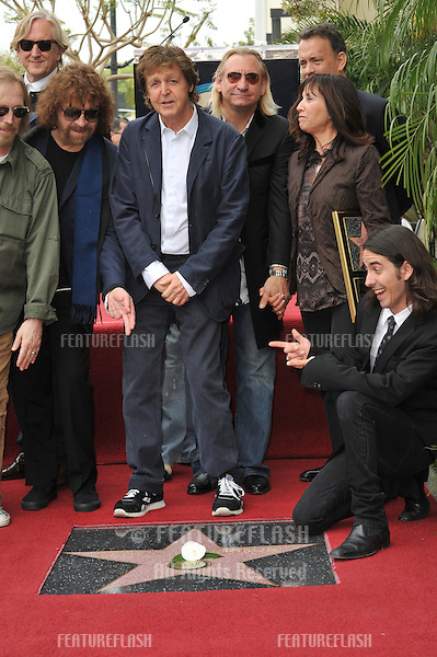 Paul McCartney with Olivia Harrison & Dhani Harrison, Tom Petty & Jeff Lynne at Hollywood Walk of Fame star ceremony honoring the late George Harrison. The star was placed outside the famous Capital Records building in Hollywood..April 14, 2009  Los Angeles, CA.Picture: Paul Smith / Featureflash