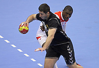 15.01.2013 Granollers, Spain. IHF men's world championship, prelimanary round. Picture show Zarko Pejovic and Selim Hedoui   in action during game between Tunisia vs Montenegro at Palau d'esports de Granollers