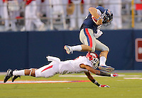 11/7/15<br /> Arkansas Democrat-Gazette/STEPHEN B. THORNTON<br /> Ole Miss's  QB Chad Kelly is brought down by Arkansas' Henre' Toliver after a long run in the third quarter during  Saturday's game in Oxford, Miss. Morgan had three TD's.