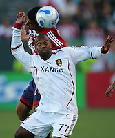 Real Salt Lake midfielder Andy Williams (77) heads a ball away from Chivas USA midfielder Paulo Nagamura (26). CD Chivas USA beat Real Salt Lake 1-0 in a MLS game at the Home Depot Center in Carson, California, Sunday, August 26, 2007.
