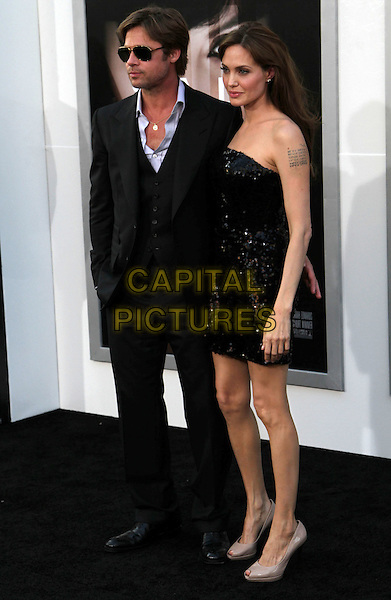 "BRAD PITT & ANGELINA JOLIE .""Salt"" World Premiere held at The Grauman Chinese Theatre, Hollywood, CA, USA, 19th July 2010..full length strapless dress sequined peep nude toe shoes heels black sequin couple suit white shirt sunglasses .CAP/ADM/KB.©Kevan Brooks/AdMedia/Capital Pictures."