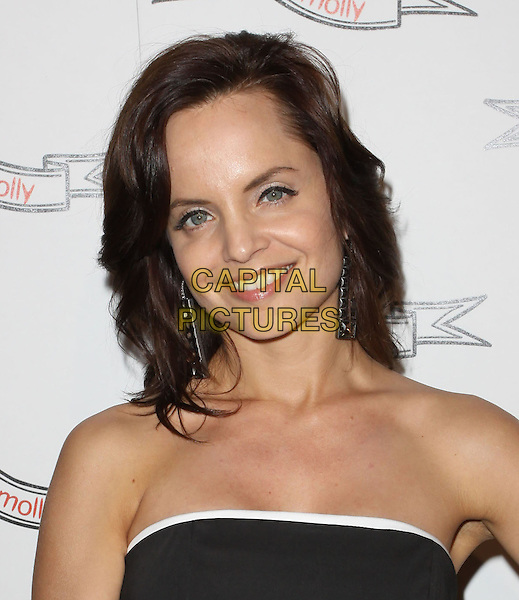 MENA SUVARI .Odd Molly Flagship Store Opening held At Odd Molly Boutique, Beverly Hills, California, USA, 19th March 2010..portrait headshot black white trim strapless smiling dangly earrings .CAP/ADM/KB.©Kevan Brooks/AdMedia/Capital Pictures.