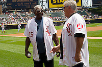 Former Chicago White Sox teammates Dick Allen and Bill Melton talk before the Major League Baseball game featuring the Chicago White Sox and the Milwaukee Brewers on June 24, 2012 at US Cellular Field in Chicago, Illinois. The White Sox celebrated the 40th anniversary of their memorable 1972 team. (Andrew Woolley/Four Seam Images).