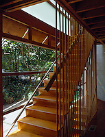 On the landing the ceiling joists are exposed and the staircase has an open grille balustrade
