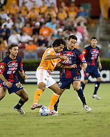 Houston Dynamo midfielder Dwayne De Rosario and Atlante FC forward Luis Gabriel Rey battle for control of the ball.  Houston Dynamo leads Atlante FC 3-0 at halftime during the group stage of the Superliga tournament at Robertson Stadium in Houston, TX on July 12, 2008.
