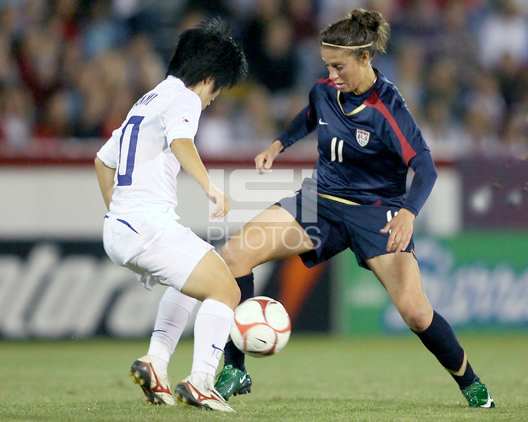 Carli Lloyd (11) of USA goes in for a tackle against Lee Jang Mi (10) of South Korea during an international friendly match at City Stadium on November 1, 2008 in Richmond, Virginia. USA won 3-1. Photo by Tony Quinn / isiphotos.com