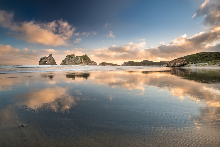 Sunrise reflections on Wharariki Beach, Golden Bay New Zealand - stock photo, canvas, fine art print