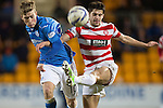 St Johnstone v Hamilton Accies...04.01.15   SPFL<br /> Stephen Hendrie clears from David Wotherspoon<br /> Picture by Graeme Hart.<br /> Copyright Perthshire Picture Agency<br /> Tel: 01738 623350  Mobile: 07990 594431