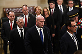 Acting Attorney General, Matthew Whitaker (2R), Secretary of the Treasury, Steven Mnuchin (R), and Secretary of Defence James Mattis (2L) look on as they leave after a ceremony for former US President George H.W. Bush at the US Capitol during the State Funeral in Washington, DC, December 3, 2018. - The body of the late former President George H.W. Bush travelled from Houston to Washington, where he will lie in state at the US Capitol through Wednesday morning. Bush, who died on November 30, will return to Houston for his funeral on Thursday. (Photo by Brendan SMIALOWSKI / AFP)