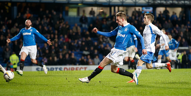 Tom Walsh attempts a shot on goal as Kris Boyd hovers