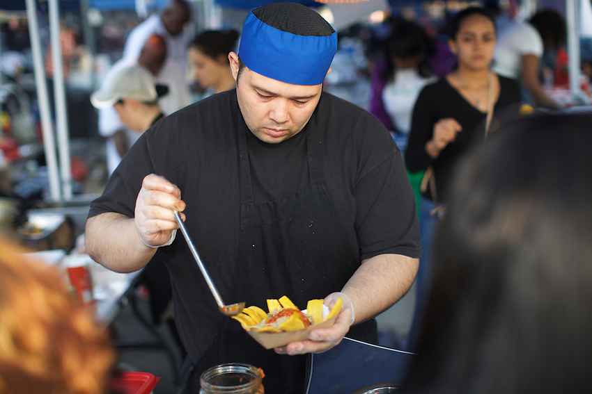Queens, NY - April 22, 2016: The Queens International Night Market opens for its second year in Flushing Meadows Corona Park.<br /> <br /> CREDIT: Clay Williams for Gothamist.<br /> <br /> &copy; Clay Williams / claywilliamsphoto.com