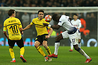 Moussa Sissoko of Tottenham Hotspur and Achraf Hakimi and Mario Gotze of Borussia Dortmund during Tottenham Hotspur vs Borussia Dortmund, UEFA Champions League Football at Wembley Stadium on 13th February 2019