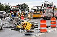 NWA Democrat-Gazette/DAVID GOTTSCHALK  Members of the Fayetteville Fire Department and other Emergency personnel clear the northbound lane of Interstate 49 south of the Porter Road exit Friday, September 11, 2015 following a semi truck accident in Fayetteville. The vehicle hit the guard rail on the interstate shutting down one lane and spilling 125-150 gallons of fuel and oil.