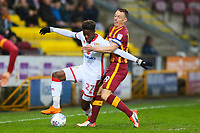 Ike Ugbo of Mk Dons and Tony McMahon of Bradford City during the Sky Bet League 1 match between Bradford City and MK Dons at the Northern Commercial Stadium, Bradford, England on 24 April 2018. Photo by Thomas Gadd.