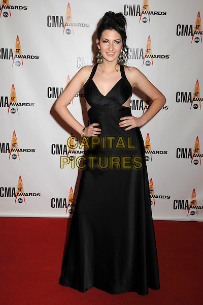 KATIE ARMIGER.43rd Annual CMA Awards, Country Music's Biggest Night, held at the Sommet Center, Nashville, Tennessee, USA..November 11th, 2009.full length black dress hands on hips.CAP/ADM/LF.©Laura Farr/AdMedia/Capital Pictures.