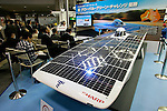 DECEMBER 10, 2009 - TOKYO - JAPAN: A solar car created by Tokai University and using Sharp Solar Cells is displayed on Sharp booth during the Eco-Product 2009 in Tokyo Big Sight. Some 700 exhibitors introduce their consumer goods, industrial materials, energies, finance and various services during three days. New environmental technologies and services that aim to change conventional wisdom, and new business models that aim to solve specific problems, including company coalitions and regional cooperation are displaying. In addition, 20,000 students in the Kanto Region as a school activity, and families can experience the low-carbon lifestyle of the near-future. 180,000 visitors are expected to attend (photo by Laurent Benchana/Nippon News).