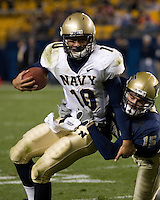 Navy quarterback Kaipo-Noa Kaheaku-Enhada (10) is tackled by Pitt linebacker Shane Murray (15).  The Navy Midshipmen beat the Pitt Panthers 48-45 in double overtime on October 10, 2007 at Heinz Field, Pittsburgh, Pennsylvania.