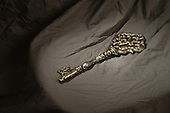 Old vintage key on cloth with mysterious lighting