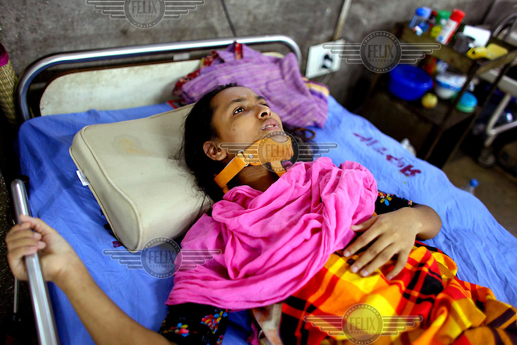 Khadeza, 18, sustained a neck injury when she was working in the Raza Plaza complex in Savar on the outskirts of Dhaka which collapsed, killing over 1,000 and injuring thousands more. She will need at least 6 months to recover from her injuries. The 8 storey Rana Plaza complex, which housed a number of garment factories employing over 3,000 workers, collapsed on 24 April 2013. By 29 April, at least 380 were known to have died while hundreds remained missing. Workers who were worried about going to work in the building when they noticed cracks in the walls were told not to worry by the building's owner, Mohammed Sohel Rana, who is a member of the ruling Awami League's youth front. He fled his home and tried to escape to neighbouring India after the building collapsed but was caught by police and brought back to Dhaka. Some of the factories working in the Rana Plaza building produce cheap clothes for various European retailers including Primark in the UK and Mango, a Spanish label. The final death toll was 1,127. /Felix Features
