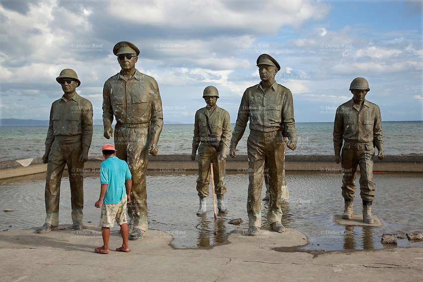Philippines. Province Leyte. Palo. MacArthur Landing Memorial Park is located at Red Beach in barangay (neighbourhood) Candahug. A filippino man stands close to the five bronze statues on the shotre of the Philippine sea in the Pacific Ocean. The McArthur Landing Site was created to commemorate Gen. Douglas MacArthur first landed to liberate the Philippines from the Japanese occupation on October 20, 1944. The Allied landing on Leyte Island'sea shores was a pivotal moment in the history of the War in the Pacific. The philippine governement has declared in 2004 that the monument was a national historical landmark. Palo is distant 10 km from Tacloban and was heavily hit by Typhoon Haiyan, known as Typhoon Yolanda in the Philippines, an exceptionally powerful tropical cyclone that devastated the Philippines. Haiyan is also the strongest storm recorded at landfall in terms of wind speed. Typhoon Haiyan's casualties and destructions occured during a powerful storm surge, an offshore rise of water associated with a low pressure weather system. Storm surges are caused primarily by high winds pushing on the ocean's surface. The wind causes the water to pile up higher than the ordinary sea level. 1.12.13 © 2013 Didier Ruef
