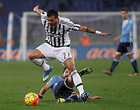 Calcio, Serie A: Lazio vs Juventus. Roma, stadio Olimpico, 4 dicembre 2015.<br /> Juventus&rsquo; Stefano Sturaro is tackled by Lazio&rsquo;s Marco Parolo, bottom, during the Italian Serie A football match between Lazio and Juventus at Rome's Olympic stadium, 4 December 2015.<br /> UPDATE IMAGES PRESS/Isabella Bonotto