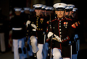 Washington, DC - July 24, 2009 -- The United States Marine Corps Silent Drill Team performs at the Evening Parade held at the Washington Marine Corps Barracks on Friday, July 24, 2009.  .Credit: Kristoffer Tripplaar / Pool via CNP