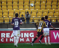 Two young fans watch the match during the A-League football match between Wellington Phoenix and Perth Glory at Westpac Stadium, Wellington, New Zealand on Sunday, 16 August 2009. Photo: Dave Lintott / lintottphoto.co.nz