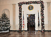 "Washington, DC - December 3, 2008 -- Entrance to the Blue Room showing the red, white, and blue garland around the entrance from the Grand Foyer of the White House during a media preview of the 2008 holiday decorations and tasting event on the State Floor of the White House in Washington, D.C. on Wednesday, December 3, 2008.  The theme of this years decorations is ""a Red, White, and Blue Christmas""..Credit: Ron Sachs / CNP"