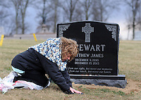 Rosemary Stewart leans in and says a prayer at the gravesite of her son, Matthew Stewart Thursday, February 2, 2017 at All Saints Cemetery in Newtown, Pennsylvania. Stewart had purchased a family plot, and the cemetery people placed her son's gravesite too close to the street, leaving the family unable to place the tombstone they had chosen. After much back and forth the cemetery agreed to move the casket over to the next plot further away from the street, thus enabling the tombstone to be placed at the grave. (WILLIAM THOMAS CAIN / For The Philadelphia Inquirer)
