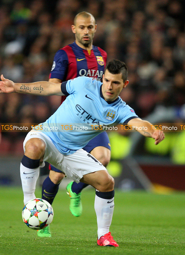 Sergio Aguero of Manchester City holds off Javier Mascherano of FC Barcelona and gets in a shot - FC Barcelona vs Manchester City - European Champions League Round of Sixteen Football at the Camp Nou Stadium on  18/03/15 - MANDATORY CREDIT: Dave Simpson/TGSPHOTO - Self billing applies where appropriate - 0845 094 6026 - contact@tgsphoto.co.uk - NO UNPAID USE