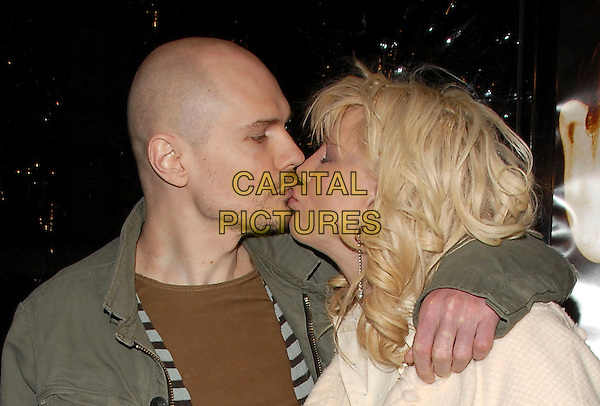 BILLY CORGAN & COURTNEY LOVE.The Paramount Pictures L.S. Premiere of Freedom Writers held at The Mann Village Theatre in Westwood, California, USA. .January 4th, 2007.headshot portrait profile arm over shoulder kiss kissing.CAP/DVS.©Debbie VanStory/Capital Pictures