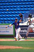St. Lucie Mets first baseman Kevin Taylor (12) stretches for a throw as Clint Coulter (40) runs through the bag during a game against the Brevard County Manatees on April 17, 2016 at Tradition Field in Port St. Lucie, Florida.  Brevard County defeated St. Lucie 13-0.  (Mike Janes/Four Seam Images)