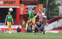 Preston North End's Callum Robinson and Brentford's Henrik Dalsgaard<br /> <br /> Photographer Rob Newell/CameraSport<br /> <br /> The EFL Sky Bet Championship - Brentford v Preston North End - Sunday 5th May 2019 - Griffin Park - Brentford<br /> <br /> World Copyright © 2019 CameraSport. All rights reserved. 43 Linden Ave. Countesthorpe. Leicester. England. LE8 5PG - Tel: +44 (0) 116 277 4147 - admin@camerasport.com - www.camerasport.com