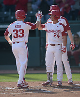 NWA Democrat-Gazette/ANDY SHUPE<br />Arkansas catcher Grant Koch (33) is congratulated at the plate by center fielder Dominic Fletcher after hitting a 2-run home run against Kent State Friday, March 9, 2018, during the second inning at Baum Stadium in Fayetteville. Visit nwadg.com/photos to see more photographs from the game.