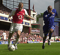 Premiership Football - Arsenal v Leicester City:.2003/04 Season - 15/05/2004  [Record breaking Season undefeated] .Fredrik Ljungberg, moving in from the wing, is chased by Jorden Stewart.[Credit] Peter Spurrier Intersport Images