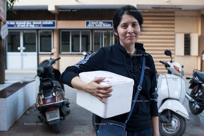 A client picks up her box of hormones, for the early stages of the treatment that a client is required to go through to produce ideal genetic material for embedding into a surrogate, at Dr. Nayana Patel's Akanksha IVF and surrogacy center in Anand, Gujarat, India on 10th December 2012. Photo by Suzanne Lee / Marie-Claire France