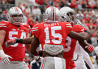 Ohio State Buckeyes running back Ezekiel Elliott (15) and Ohio State Buckeyes tight end J.T. Moore (8) celebrate a touchdown by Moore during Saturday's NCAA Division I football game against the Kent State Golden Flashes at Ohio Stadium in Columbus on September 13, 2014. (Dispatch Photo by Barbara J. Perenic)
