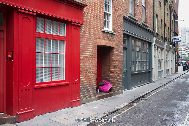 Sleeping bag in a doorway used by a rough sleeper  in  gentrified street in Shoreditch, London.