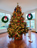 "The 2018 White House Christmas decorations, with the theme ""American Treasures"" which were personally selected by first lady Melania Trump, are previewed for the press in Washington, DC on Monday, November 26, 2018. This tree stands in the East Wing corridor that visitors will pass as they walk along the corridor.  <br /> Credit: Ron Sachs / CNP"