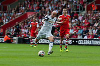 Sun 06 October 2013 Pictured:Jonjo Shelvey of Swansea takes a shot at goal  Re: Barclays Premier League Southampton FC  v Swansea City FC  at St.Mary's Stadium, Southampton