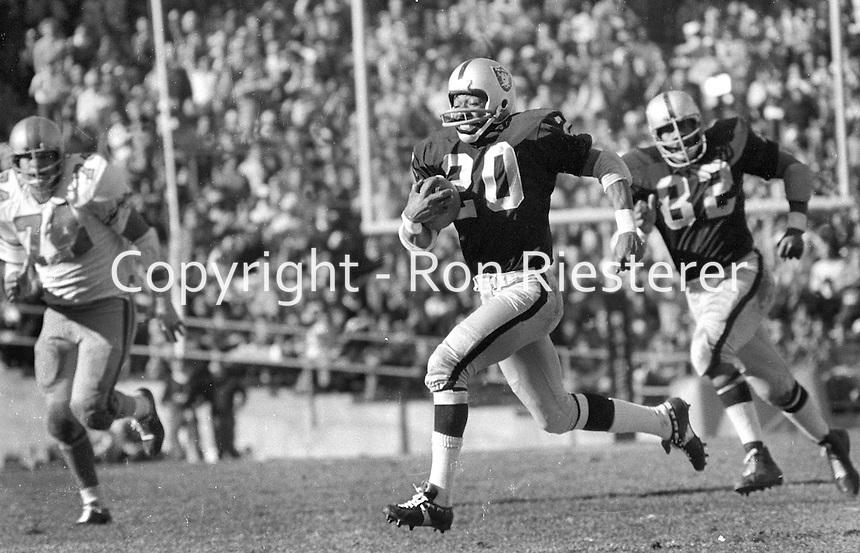 Oakland Raiders Jimmy Warren runs back interception against the Houston Oilers.. trailing is Horace Jones..(1971 photo by Ron Riesterer)
