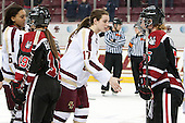 Kaliya Johnson (BC - 6), Melissa Haganey (NU - 19), Meghan Grieves (BC - 17), Kelly Wallace (NU - 5) - The Boston College Eagles celebrate winning the 2014 Beanpot championship on Tuesday, February 11, 2014, at Kelley Rink in Conte Forum in Chestnut Hill, Massachusetts.