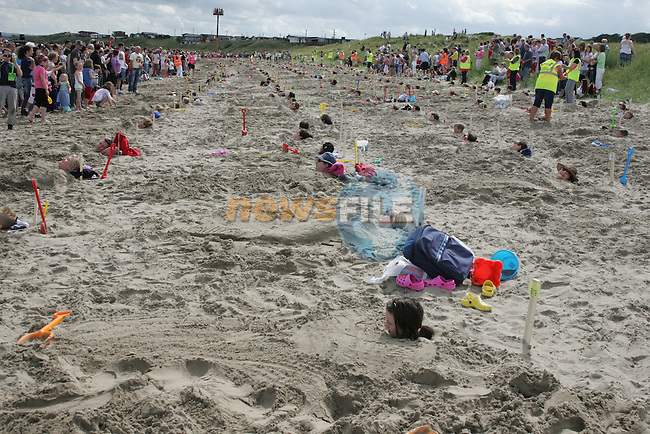 World Record ammount of people buried in the sand at the Prawn Festival in Clogherhead....Photo NEWSFILE/Jenny Matthews.(Photo credit should read Jenny Matthews/NEWSFILE)....This Picture has been sent you under the condtions enclosed by:.Newsfile Ltd..The Studio,.Millmount Abbey,.Drogheda,.Co Meath..Ireland..Tel: +353(0)41-9871240.Fax: +353(0)41-9871260.GSM: +353(0)86-2500958.email: pictures@newsfile.ie.www.newsfile.ie.FTP: 193.120.102.198.