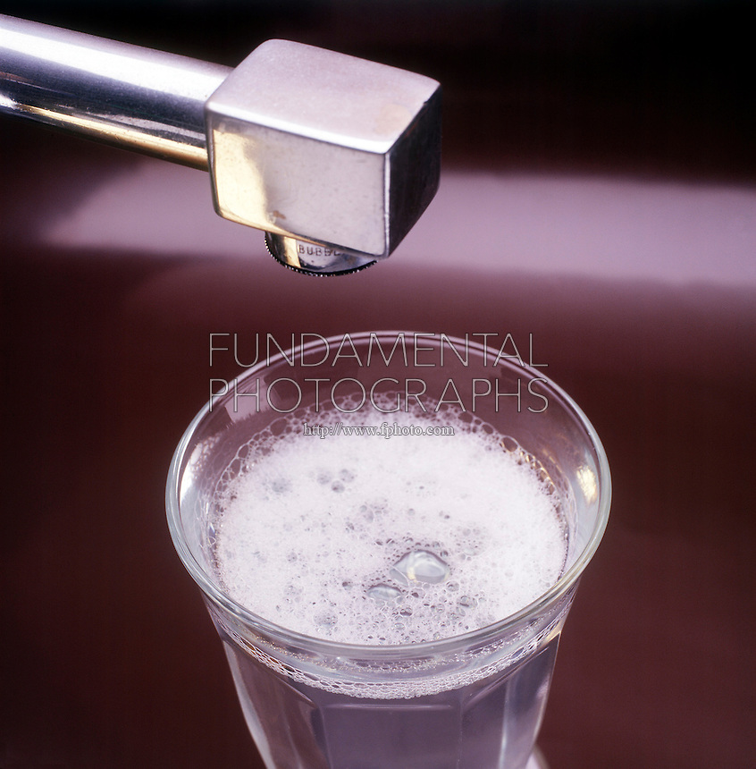 SUDS IN GLASS OF TAP WATER<br /> Alkylbenzenesulfonate (ABS) detergent<br /> One of the first cheap synthetic detergents produced from petroleum products. It was not readily broken down by microorganisms in treatment plants and began to contaminate water supplies. (Simulated photo)